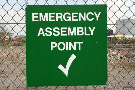 assembly point: Emergency Assembly Point sign