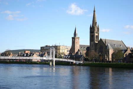 ness river: Inverness in the spring with the river Ness lined with daffodils Scotland Stock Photo