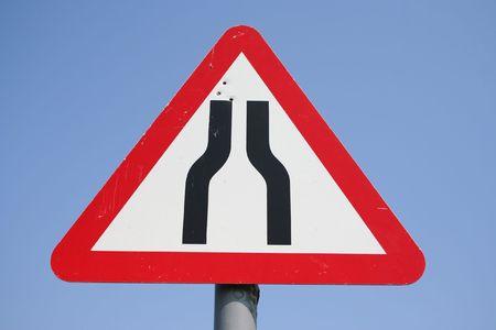 narrows: Warning road narrows ahead sign