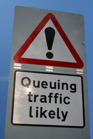 queueing: warning queuing traffic likely ahead sign Stock Photo