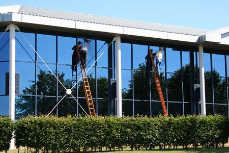 lowrise: Two window cleaners at work