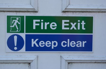 Fire exit keep clear sign photo