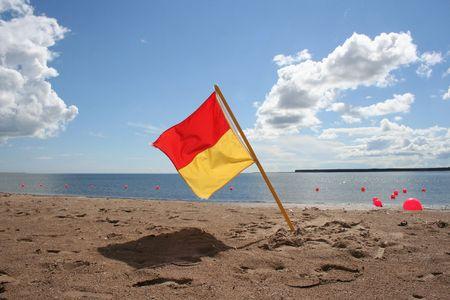 duty: Lifeguard on duty flag on beach