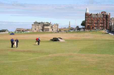 Golfers walking to Club House, St Andrews Stock Photo