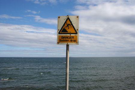 sudden: Danger sudden drop sign Stock Photo