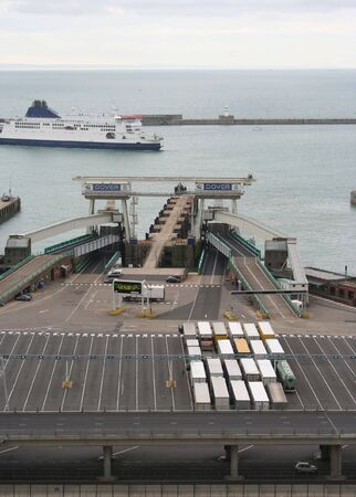 trucks driving on ferry Dover harbour photo