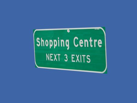 exits: shopping center next three exits sign