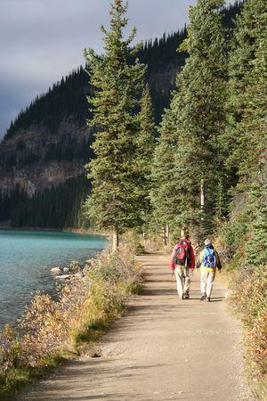 louise: elderly couple walking Lake Louise Canada Stock Photo
