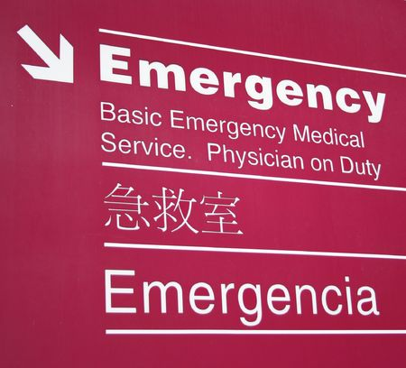 immigrants: trilingual emergency room sign English, Chinese and Spanish Stock Photo