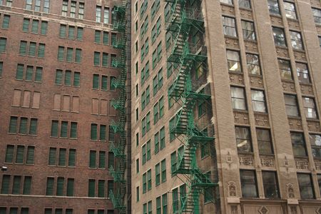 escapes: two green external fire escapes on a Chicago building