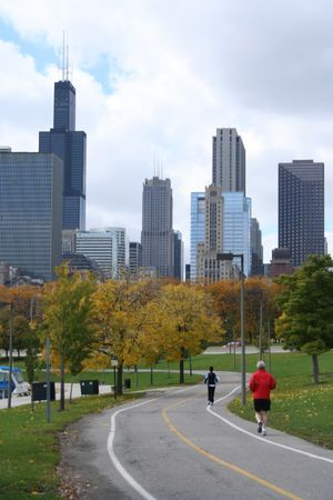 sears: elderly man jogging towards Sears Tower Chicago