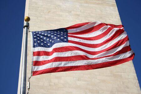 American flag and Washington monument photo