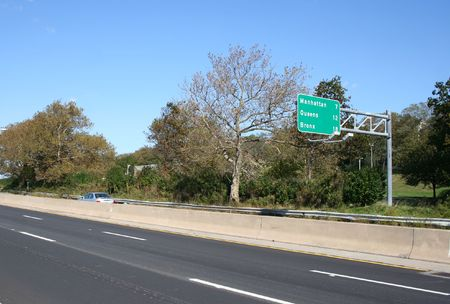 boroughs: freeway in Brooklyn New York with sign listing other boroughs Stock Photo