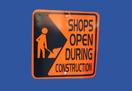 Shops open during construction sign with figure holding spade Stock Photo - 586427