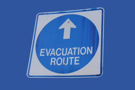 direction of the arrow: evacuation route sign blue circle with direction arrow