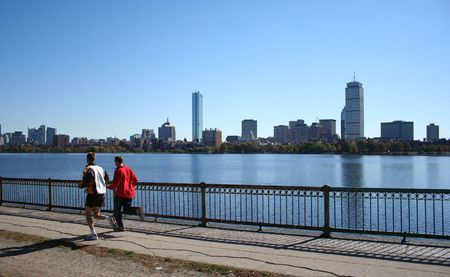 jogging by the Charles River with part of the boston Skyline