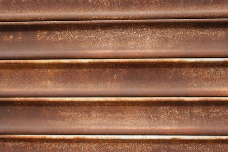 security shutters: rusted metal shutters for security and protection Stock Photo