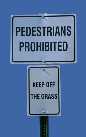 pedestrians prohibited keep off grass sign