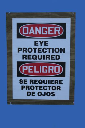 bilingual: Bilingual construction sign eye protection required