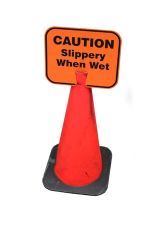 Caution slippery when wet sign photo