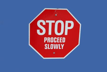 to proceed: red stop proceed slowly sign