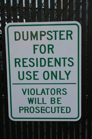 dumpster: dumpster for residents only sign violators will be prosecuted