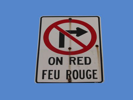 bilingual no turning right on red light in french and english Stock Photo - 601612