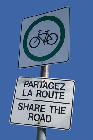 bilingual: bilingual share the road sign in french and english