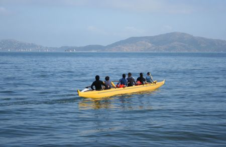 outrigger: six people in a canoe with outrigger San Francisco bay