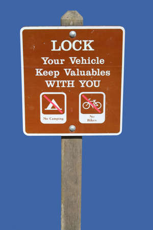 valuables: Lock your vehicle keep your valuables with you Stock Photo