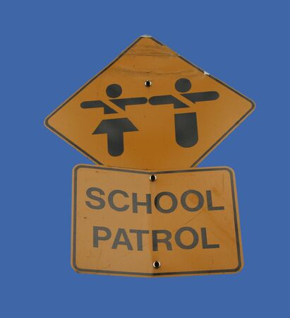 School patrol sign with crossing guards symbol photo