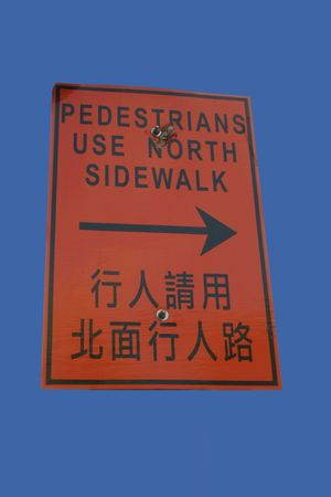 bilingual: Bilingual pedestrians use other sidewalk in English and Chinese
