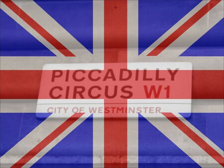 piccadilly: Piccadilly circus street sign with British flag