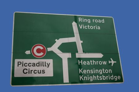 knightsbridge: Road sign at Hyde Park Corner London with Congestion charge symbol