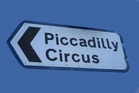 piccadilly: sign pointing towards Piccadilly Circus London England