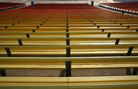 colorful painted benches of stadium seating from above photo