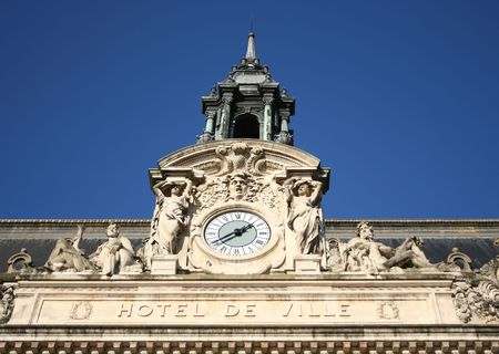ville: Hotel de Ville detail french town hall with clock