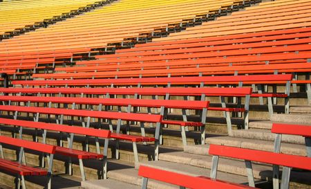 colorful painted benches of stadium seating photo