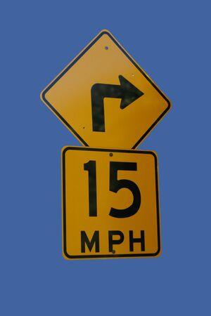 mph: 15 mph speed limit sharp bend Stock Photo