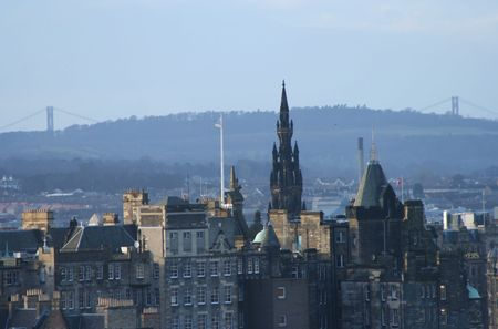 Scott Monument and towers of Forth Road Bridge Edinburgh Scotland photo