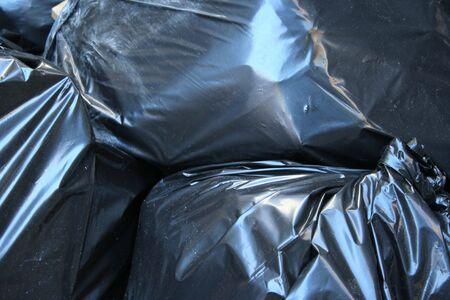 black plastic bag full of garbage background