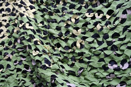 concealment: camouflage netting on military vehicle