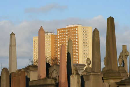 ��low income housing�: obelisks of Necropolis and tower blocks Glasgow Stock Photo