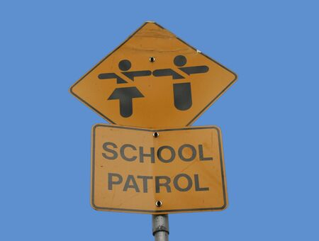 School patrol sign isolated on blue photo