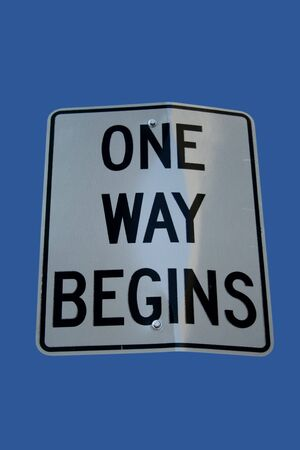 begins: One way begins sign isolated on blue