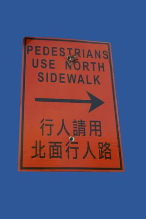 bilingual: bilingual sidewalk closed sign in English and chinese