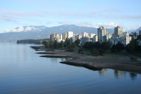 stanley: Vancouver condominiums Stanley Park and mountains Stock Photo