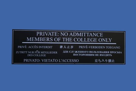 only members: multilingual Private no admittance members of the college only sign Stock Photo