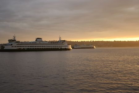 puget: Ferries passing in Puget Sound at sunset
