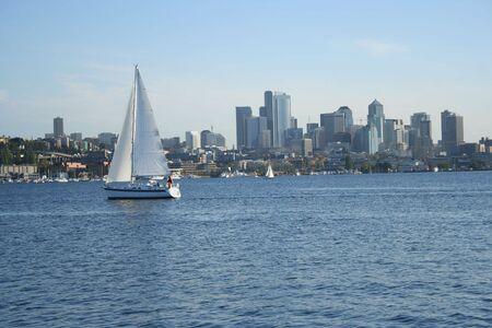 Sailing boat on lake union with Seattle skyline